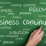 Business Continuity word cloud concept on blackboard